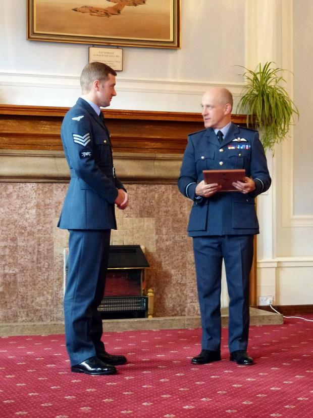 Former Ilkley Grammar School student, Sgt George Denman, left, is presented with an RAF award by Air Vice Marshal Stuart Atha