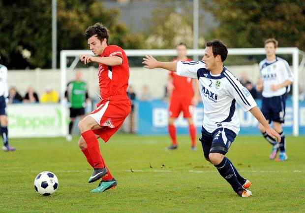 ACTION EXTRA: Andy Holdsworth, right, during Guiseley's weekend FA Cup victory
