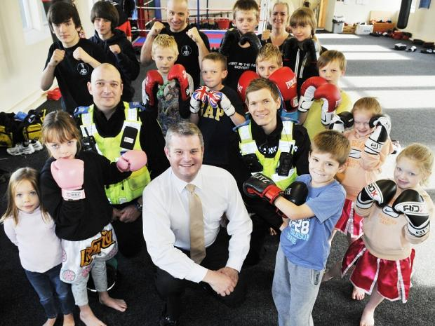 Stuart Andrew MP with PCSOs Mark Kelly (left) and Ben Greenhow and members of the Aireborough Thai Boxing Fitness Academy
