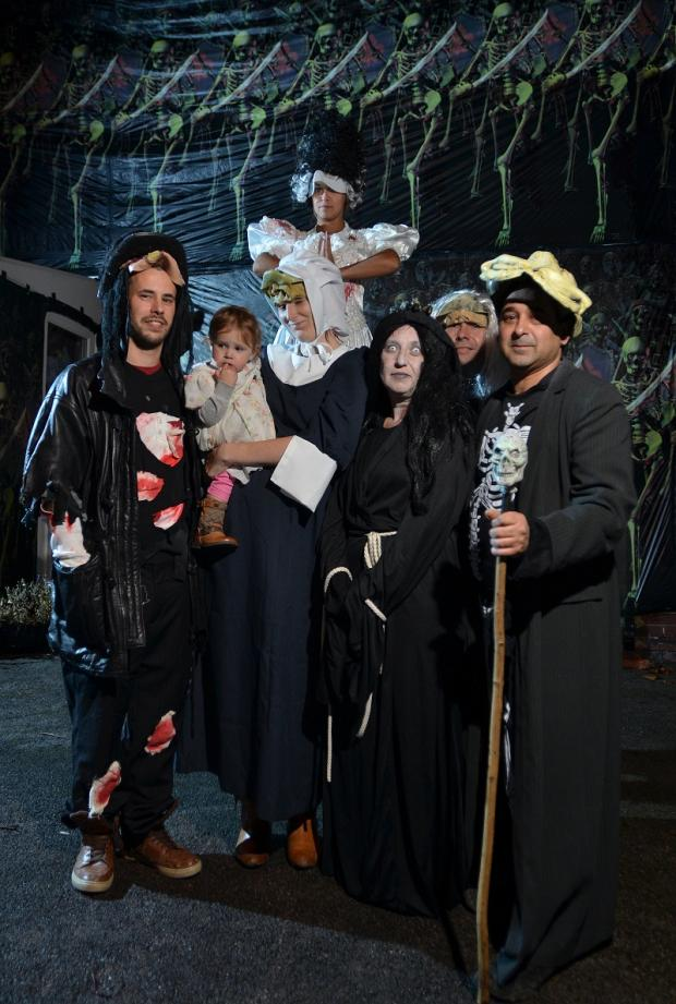 Rod Dawson and his family all dressed up to scare visitors at Halloween