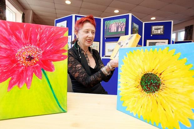 Art teacher, Susan Forster-Ross, views work from the Addingham exhibition