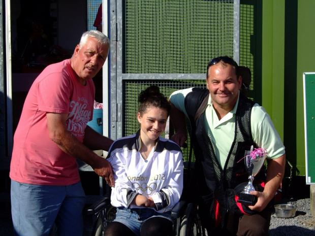 Yorkgate Gun Club owner, Bob Agar, with Danielle Bailey presenting the winner's trophy to Paul Haggas at the club's big annual fundraising Pink Day