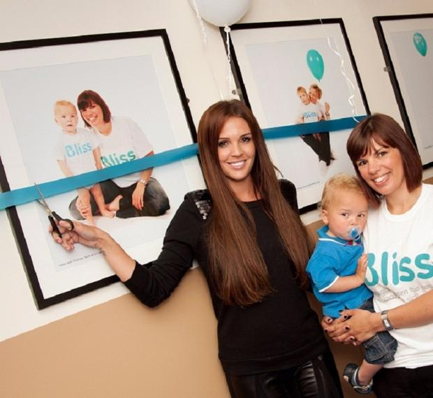 Danielle O'Hara with Otley mum Helen Jackson and son Thomas at the opening of new photo display at LGI's neonatal unit