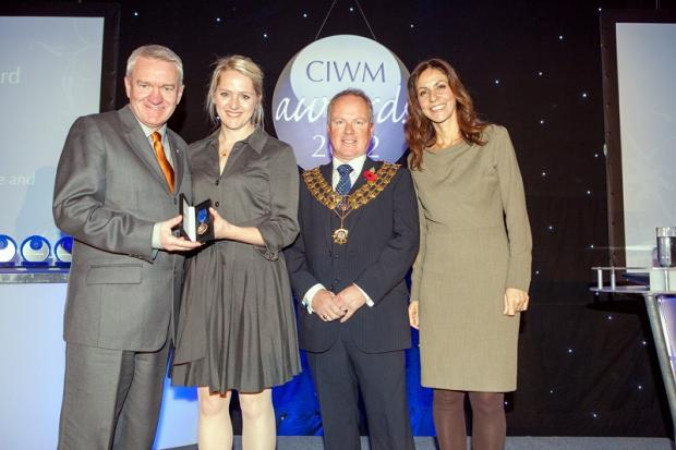 Ray Georgeson and Dr Jane Beasley receiving their award from John Skidmore, and TV's Julia Bradbury