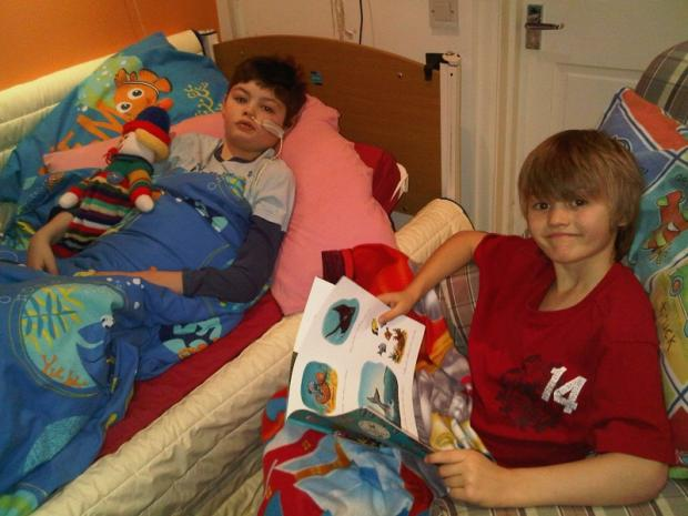 Louis Fielding reading a bedtime story to his Oliver, who received fantastic care from Martin House Hospice before his death