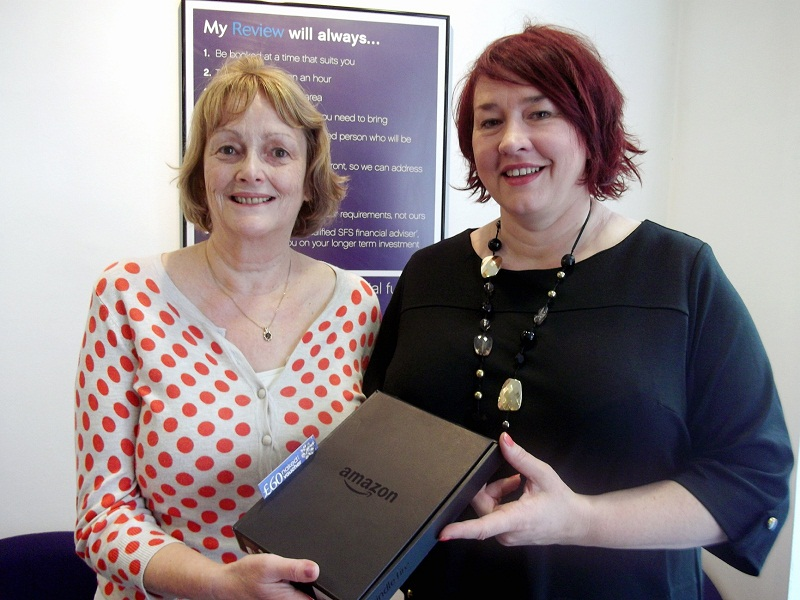 Helen Rice is presented with her Amazon Kindle by Skipton's Ilkley branch manager Debra Harper