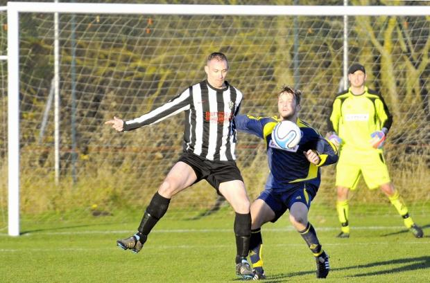 Terry Hargreaves of  Ventus beats Ilkley's Joe Hendrie to the ball