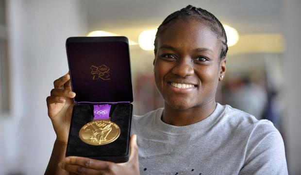 Wharfedale Observer: Nicola Adams, pictured showing her gold medal at Huggy's Gym in Bradford, is on a shortlist of 12 for the BBC Sports Personality of the Year award on Sunday, December 16