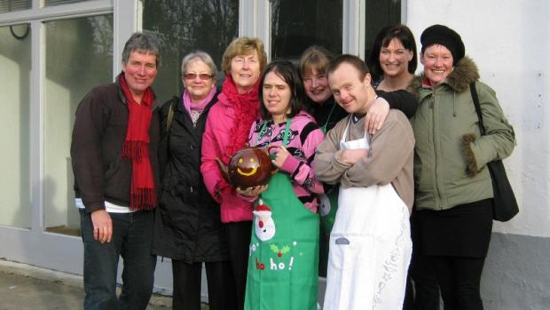 Cafe staff and volunteers with their smiley teapot and Ilkley Community Enterprise directors John Thirlwell, Louise Hale (right) and Karen Goodman-Picken (back row, second right)