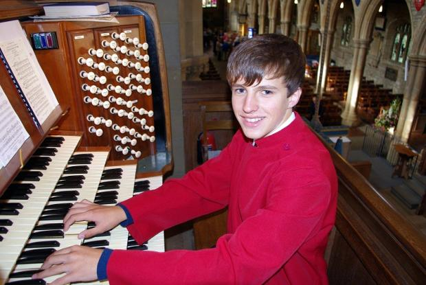 Henry Websdale, 15, at the organ keyboard