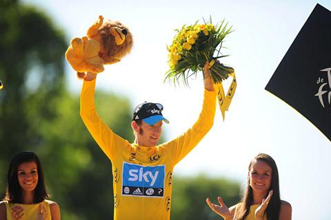 Bradley Wiggins celebrates in his famous yellow jersey after winning this year's Tour de France