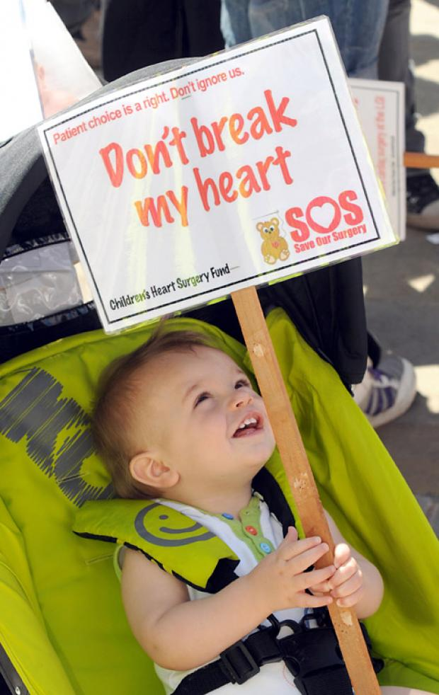 Wharfedale Observer: A young boy helps protest against closure of the Leeds children's heart surgery unit in July 2012