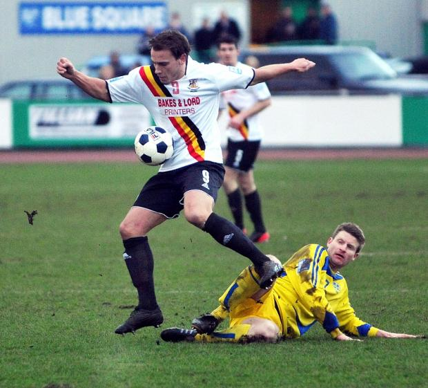 Guiseley's Nicky Boshell slides in on Avenue's Danny Holland