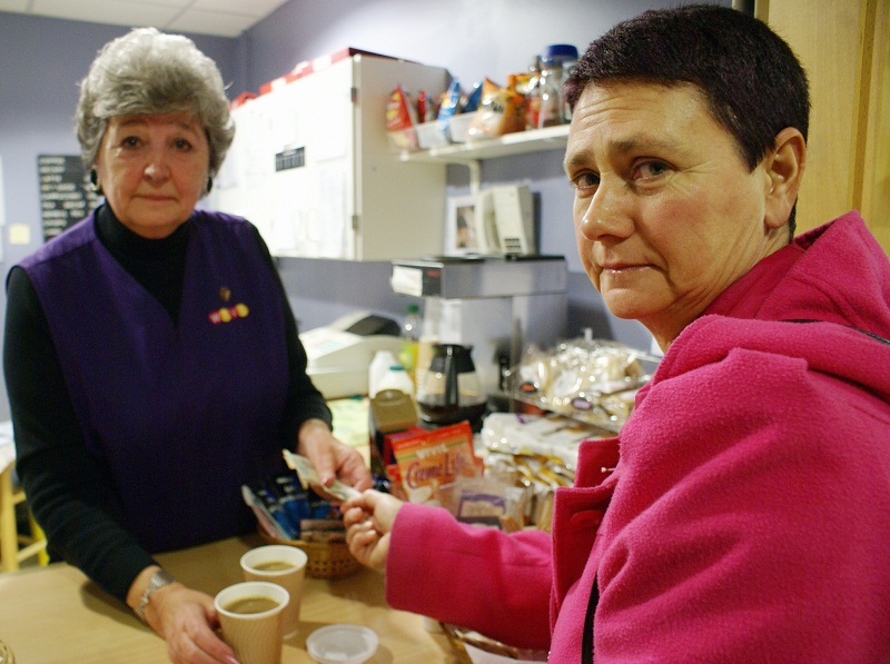 Volunteer Jan Beanland serves customer Mandy Cater at the popular WRVS tea bar at Wharfedale Hospital