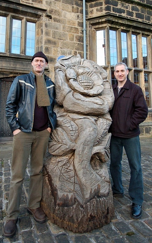 Sculptor Shane Green, left, with MP Greg Mulholland and the rose carving