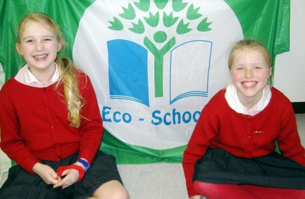Moorfield School pupils Sally Bentley, ten, and Alice Bourgeois, 11, with the Ilkley school's green flag eco award