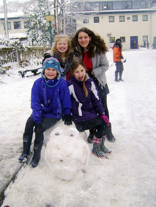 Pupils at All Saints C of E Primary School in Ilkley, which was open as  normal, enjoy playing in the snow,