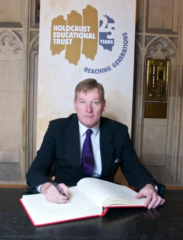Kris Hopkins MP signing the Book Commitment