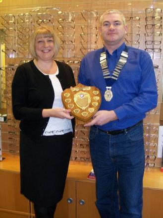 Angela Palmer is presented with the Otley Chamber of Trade Good Service Award by chamber president Tim Wilkinson.