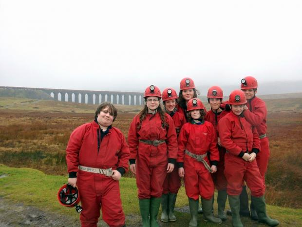 Wharfedale Observer: The year nines pose against the scenic backdrop of the Ribblehead Viaduct during their week-long stay
