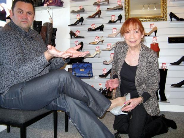 Tip Toes owner Joan Walsh trying out a shoe for size with Andrew Walton