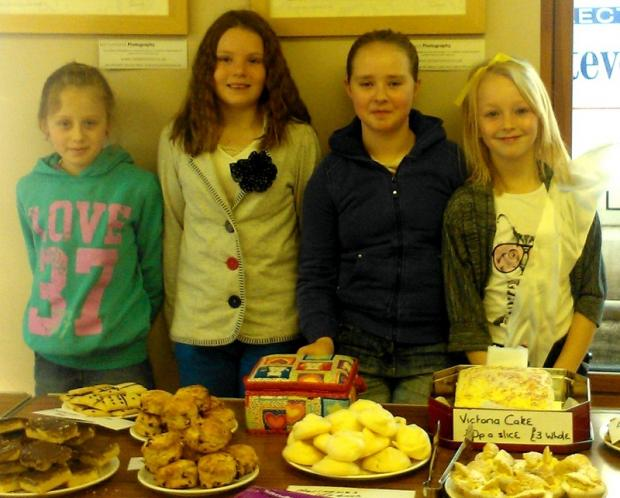 Pictured at their cake stall are, from the left, Lucy Sanderson, Rhiannon Nelson, Emma Whiteley and Bethany Young