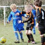 Guiseley's under-sevens' Jake Money, centre, for possession against Dudley Hill Rangers
