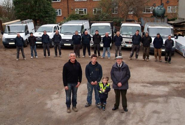 Houldsworth family members at the front, from left, are owner Richard, son Joe, Joe's son Archie, and the company's founder, Bas