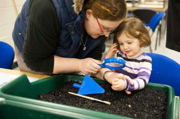 Fiona Lee, left, with Isla Wilkins at an Archaeology Family Fun Day.  Image by Pennine Prospects/Sarah Mason