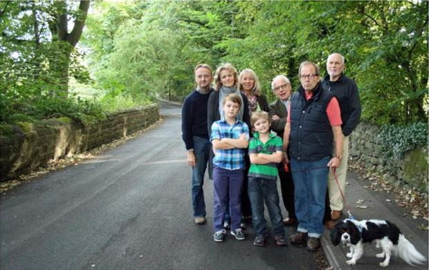 Opponents of housing on the Outwood Lane site, back row from left, are Richard and Elspeth Taylor, Karen Crosland, David Hanson and Rick Amos. Front row, Zachary and Elijah Taylor, and Bob Kidd. Photograph by Peter Crosland