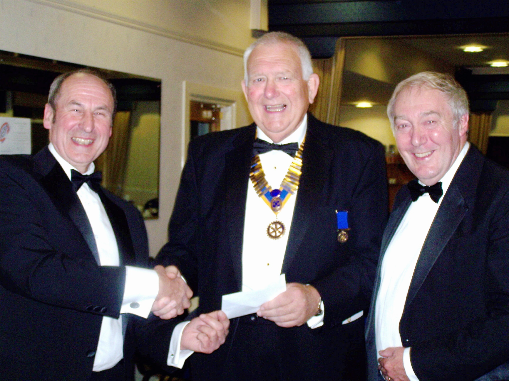 From left are Otley Beer Festival committee member Alan Raw, president of the Rotary Club of Otley Keith Thompson, and committee member Jeff Utley