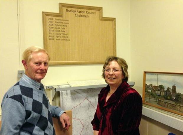 Bruce Speed and former Parish Councillor Caroline Jones with the new board to honour chairmen of Burley Parish Council.