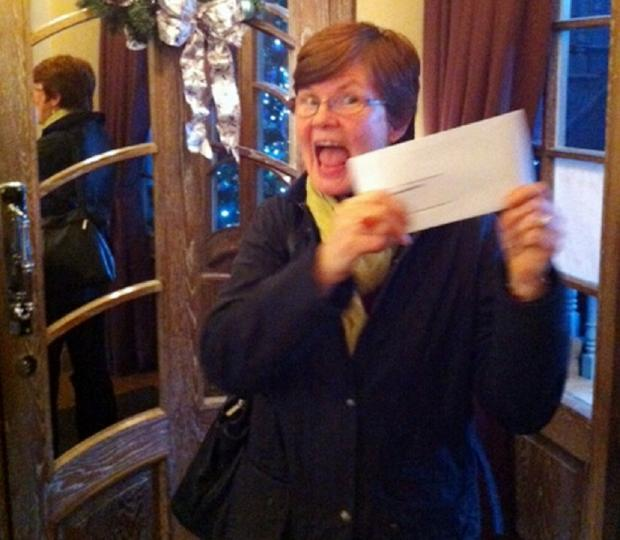 A delighted Mary Hamilton shows off her £150 prize