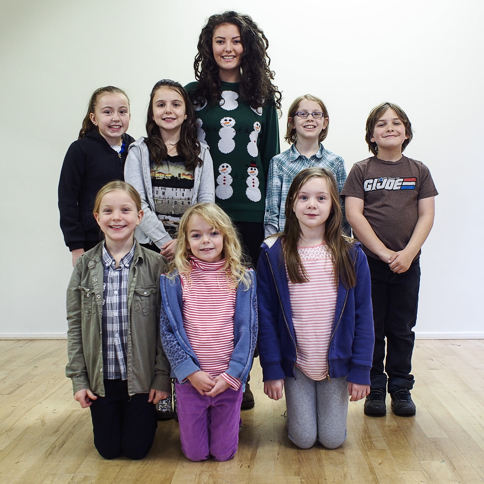 Charlotte Coles, centre, who will be playing Snow White, with her seven dwarfs.