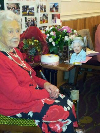 Mary Aivison with her card from the Queen