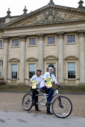 Local Marie Curie nurses Sarah Smith and Helen King on their tandem outside Harewood House