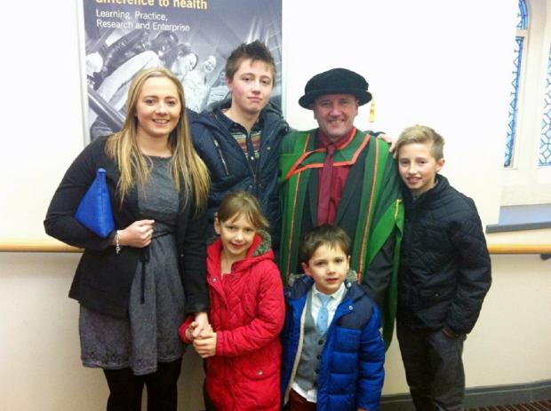 Tony Gill with his five children on graduation day