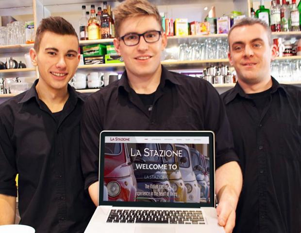 La Stazione manager and coffee artist in residence Max Crane, centre, showing off the new website wit