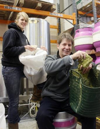 Ilkley Brewery's Christa Sandquist with competition winner Ian Grant, creating his pale ale