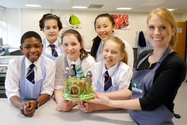 Wharfedale Observer: Zoe Hopkinson of Zoe's Fancy Cakes (far right) with year seven
