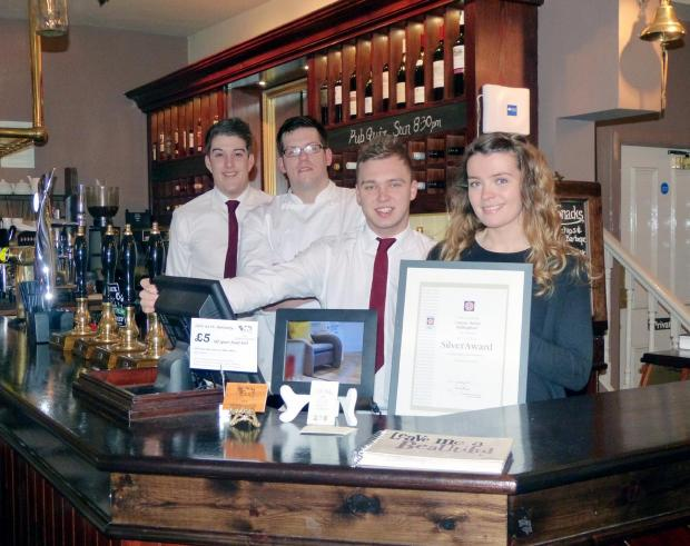 From the left are Craven Heifer floor supervisor Peter Osborne, executive chef Mark Owens, bar supervisor Dave Randviir and restaurant manager Maxine Ovens with their Visit England Silver Award
