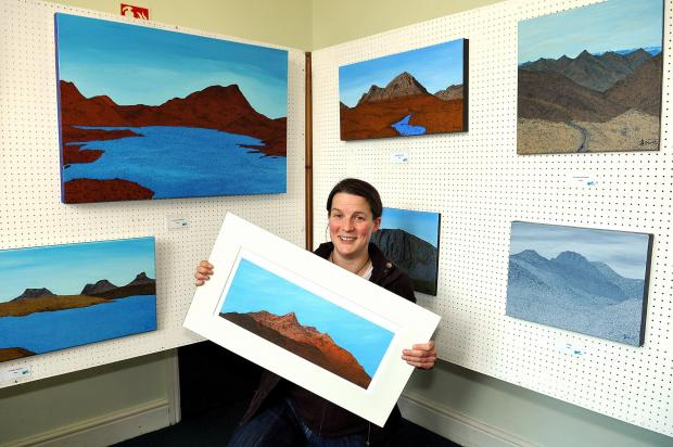 Heather Dawe with some of her artwork