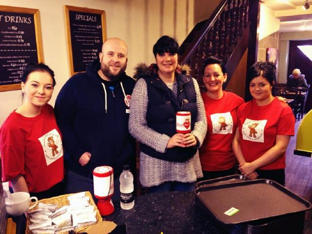 Wharfedale Observer: At the Rumblin' Tum cafe's fundraiser are, from left, Emma Raffety, Matt Hey, Karen Middleton, Lisa Can, and Fiona Reynolds. Matt and Karen's son, like the cafe's owners' son, has benefited from surgery at the Leeds General Infirmary unit