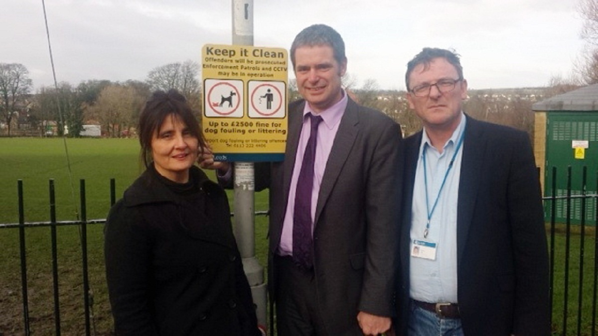 Otley resident Lisa Gustafson, of anti-dog fouling group Muck Up, with councillors Ryk Downes and Sandy Lay beside one of the new penalty warning signs