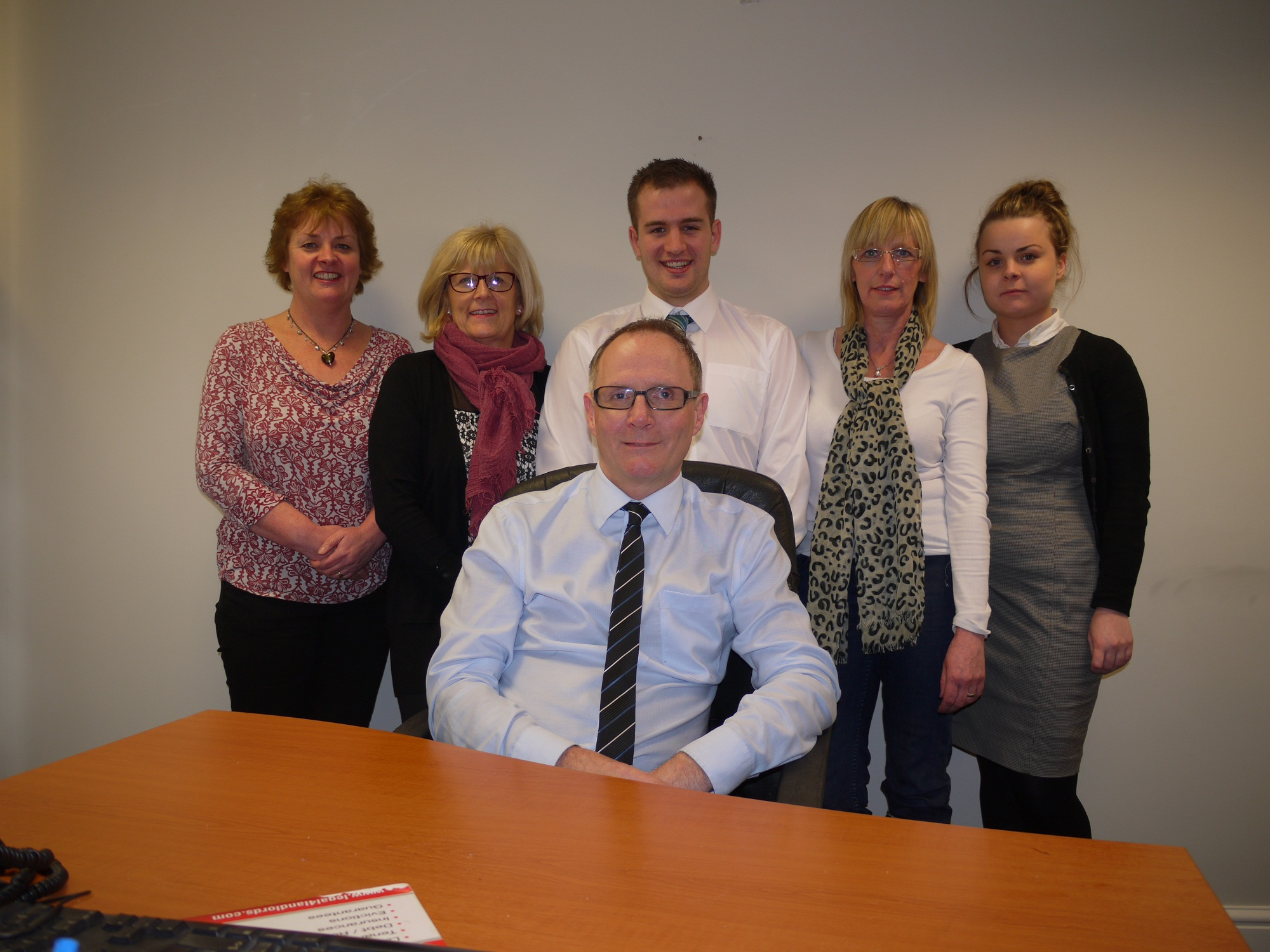 Pictured from left are Parkes & Co staff Lucinda Parkinson (partner), Wendy Ramage, Richard Rhodes,  Karen Hammond and Jessica Parkinson, with partner Andrew Parkinson seated