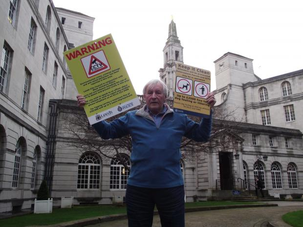 Wharfedale Observer: Councillor Brian Cleasby outside Leeds Town Hall with the camera warning signs