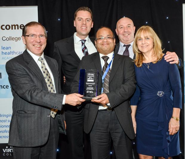 Bob Gomersall, managing director of Virtual College Ltd, presents the Improving Services through Training and Development Award to Central Manchester University Hospitals NHS Foundation Trust