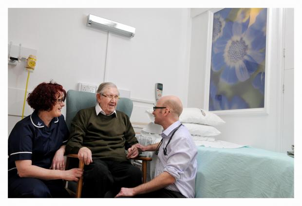 Wharfedale Observer: Pictured are Airedale Hospital Ward 6 sister Sarah Robinson with patient Ronald Ford and consultant Robert Marshall