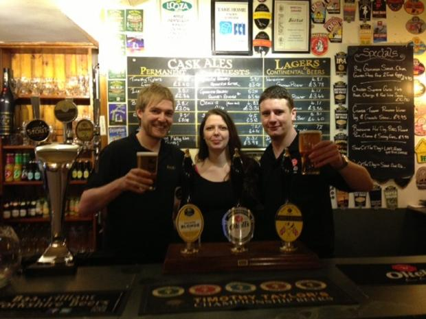 Bar T'at general manager Amy Keegan celebrating the top Cask Marque score with staff members Colin Butler, left, and Alex Taylor