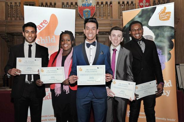 Minhazul Abedin, left, with other successful members celebrating being elected to the UK Youth Parliament.